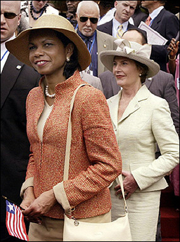 US Secretary of State Condoleezza Rice (L) and US First Lady Laura Bush depart after attending Liberian President Ellen Johnson-Sirleaf's swearing-in ceremnoy in Monrovia, 16 January 2006. Rice said she was flattered that Laura Bush thought she would make a good president, but her response is still 'thanks but no thanks'.(AFP/Jim Watson)
